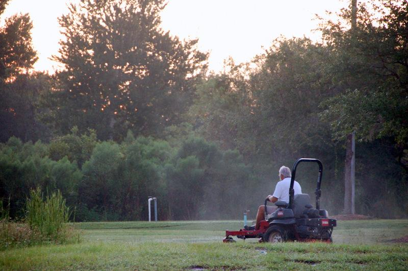 Mowing in the Morning Mist