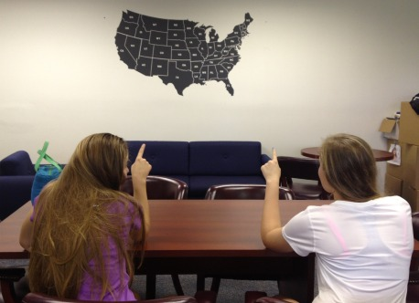 Upcoming Seniors Jansen Humphrey and Emily Camire point on the map to their dream college location