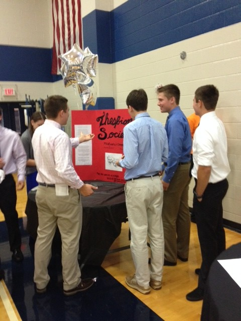 Joey Coco, Alex Seftas, Todd Humphrey, and Parke Phillips gather to learn more about the Thespian Society.