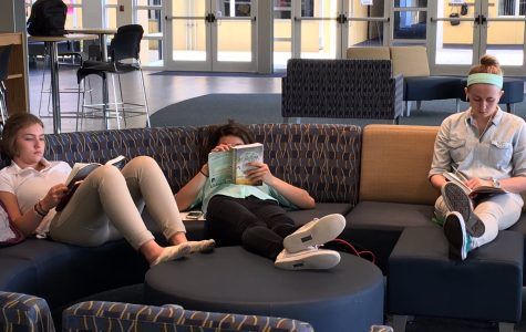 Juniors Paula Klar, Nicole Petron, and Amber Bond settle into some reading on Wednesday morning in a peaceful Student Center.