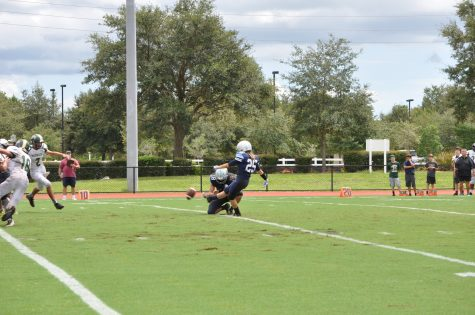 Number 25, Christina Lutton, earns the Thunder an extra point after a touchdown.