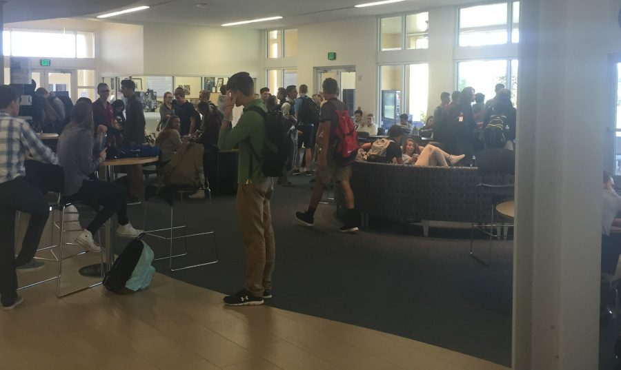 Many students mulling about in the Student Center during the Community Work Period.